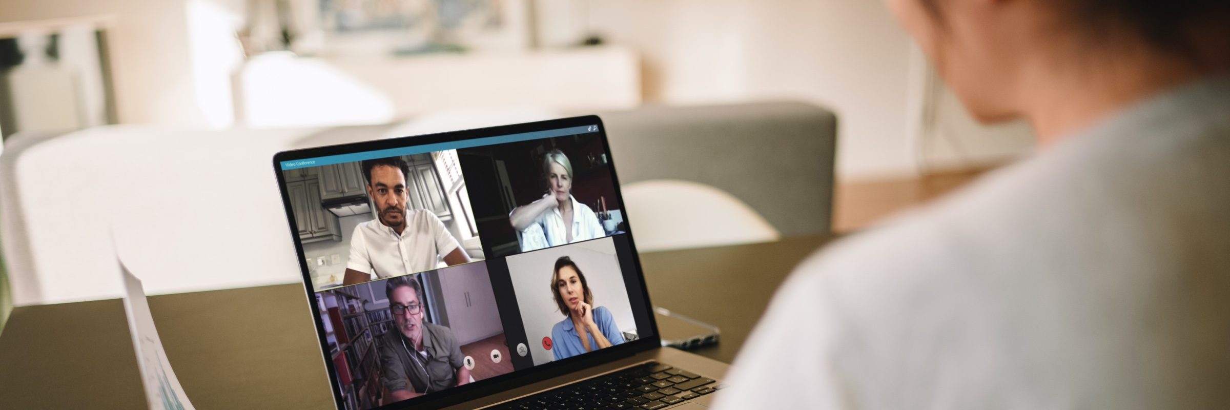 Person having a video call on laptop