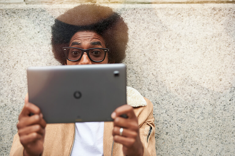 person looking at a tablet